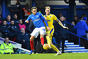 Brandon Haunstrup (38) of Portsmouth is challenged by Mitch Pinnock (11) of AFC Wimbledon during the EFL Sky Bet League 1 match between Portsmouth and AFC Wimbledon at Fratton Park, Portsmouth, England on 1 January 2019.