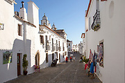 Historic cobbled street whitewashed buildings walled hilltop village of  Monsaraz, Alto Alentejo, Portugal, southern Europe