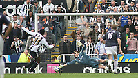Shola Ameobi scores the 2nd goal for Newcastle United with a penalty past Tomasz Kuszczak in the West Bromwich Albion goal