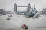 UNITED KINGDOM, London: 09 September 2015 A flotilla of boats passes the HMS Belfast (far right) and Massey Shaw Fire Boat (second from right) after going under Tower Bridge this afternoon to mark the day the Queen becomes Britain's longest reigning monarch. Credit: Story Picture Agency