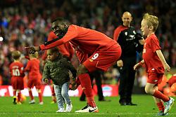 Christian Benteke of Liverpool with his son - Mandatory byline: Matt McNulty/JMP - 11/05/2016 - FOOTBALL - Anfield - Liverpool, England - Liverpool v Chelsea - Barclays Premier League