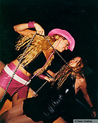 Two girls, one pulling a chain around the other girls neck, Ibiza, 2000