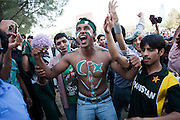 Pakistan: Thousands of Pakistani Cricket supporters watched a live broadcast of the Semi-Final Cricket World Cup match between India and Pakistan...The match was shown live on a screen hung on the side of the Islamabad Stock Exchange (ISE) in Islamabad. ..Adjacent roads were closed to traffic and police/security presence was minimal. A party atmosphere ensued until almmost on the 8 hour mark India wrapped up the match beating Pakistan by 29 runs in Mohali, India, to reach the Cricket World Cup final...A number of large display screens were erected across the city in cafe's, market areas, restaurants and communal spaces. ..The government declared a half day holiday across the country. Its estimated that 1 billion people across the world watched the game live....Pakistan/Jason Tanner/March 2011