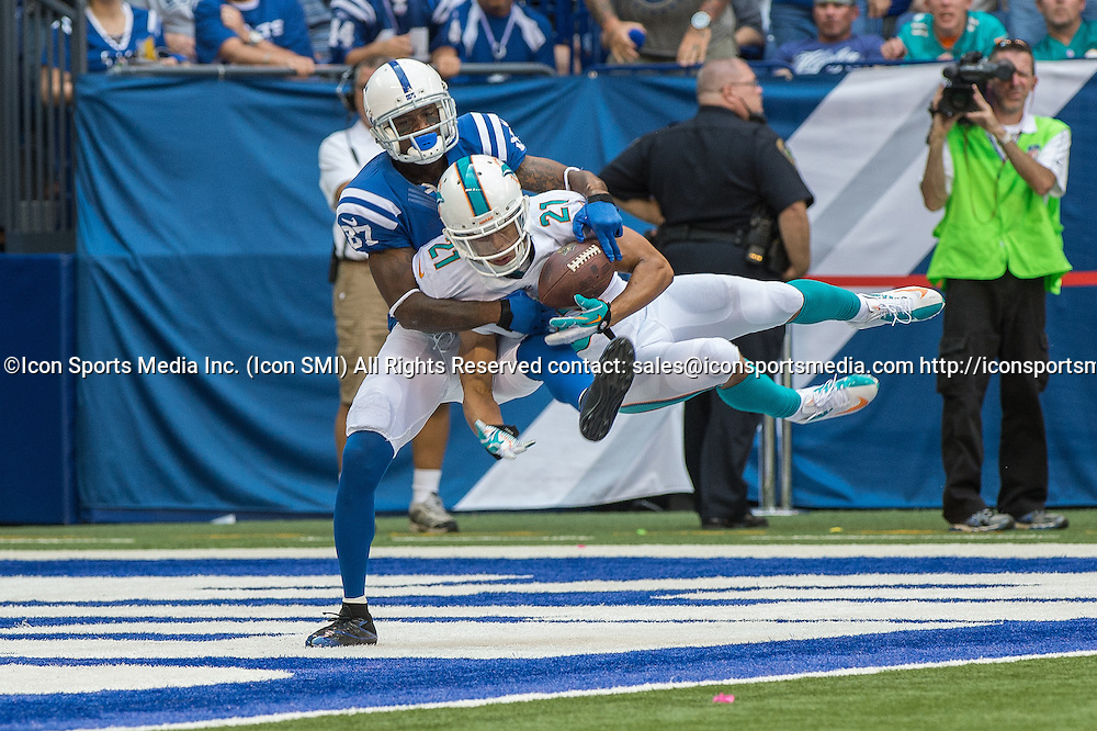 September 15, 2013: Miami Dolphins cornerback Brent Grimes (21) intercepts a pass intended for Indianapolis Colts wide receiver Reggie Wayne (87) during the football game between the Indianapolis Colts vs Miami Dolphins at Lucas Oil Stadium in Indianapolis, IN.