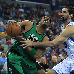 11 February 2009:  Boston Celtics forward Paul Pierce (34) is defended by New Orleans Hornets forward Peja Stojakovic (16) during a NBA game between the Boston Celtics and the New Orleans Hornets at the New Orleans Arena in New Orleans, LA.