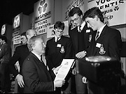 08/01/1988.01/08/1988.8th January 1988 .The Aer Lingus Young Scientist of the Year Award at the RDS, Dublin ..Picture shows the Taoiseach Charles Haughey, T.D. presenting the runner-up group prize to three students from Terenure College. (names unknown)