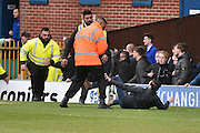 Milwall fans  ands stewards scuffle during the Sky Bet League 1 match between Bury and Millwall at the JD Stadium, Bury, England on 23 April 2016. Photo by Mark Pollitt.