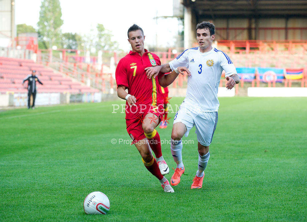 WREXHAM, WALES - Wednesday, August 15, 2012: Wales' Billy Bodin in action against Armenia's Kieron Freeman during the UEFA Under-21 Championship Qualifying Round Group 3 match at the Racecourse Ground. (Pic by Dave Richards/Propaganda)