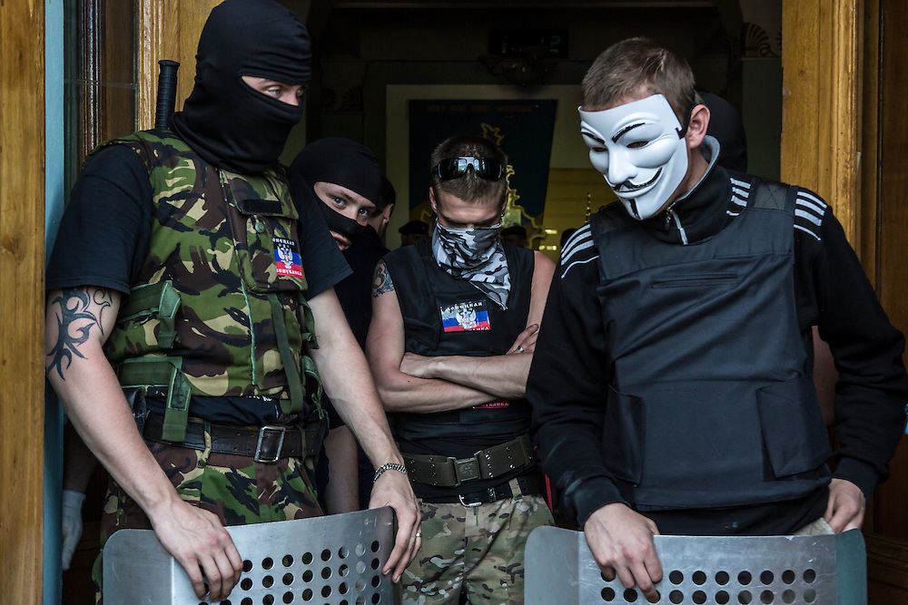 DONETSK, UKRAINE - APRIL 27: Pro-Russian activists guard the entrance to TRK Donbass television station after taking over the building on April 27, 2014 in Donetsk, Ukraine. Pro-Russian activists have been occupying government buildings and demanding greater autonomy in at least ten Eastern Ukrainian cities in recent weeks, prompting the government in Kiev to threaten military action to retake control of the cities. (Photo by Brendan Hoffman/Getty Images) *** Local Caption ***
