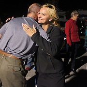 Candidate for Carolina Beach Town Council LeAnn Pierce hugs Jim Norwood outside of the Carolina Beach Recreation Center November 5, 2013. (Jason A. Frizzelle)