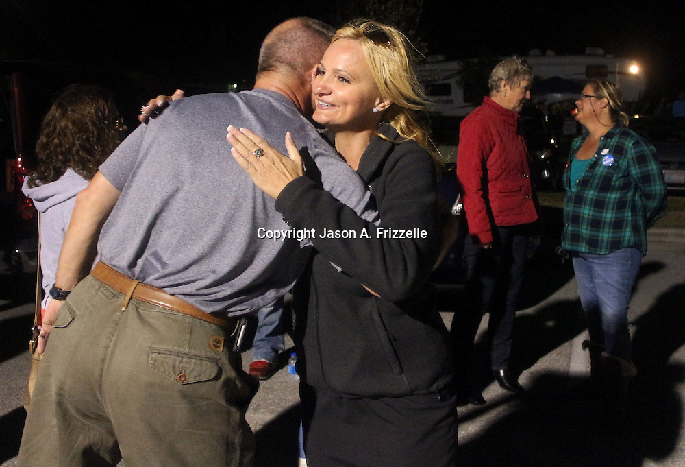 Candidate for Carolina Beach Town Council LeAnn Pierce hugs Jim Norwood outside of the Carolina Beach Recreation Center November 5, 2013. (Jason A. Frizzelle)