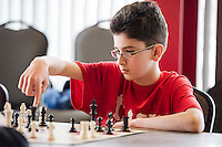 Noah Mousseau from Laconia Middle School thinks about his move before removing his finger during the  Laconia City Wide Chess Tournament at the Huot Center Saturday morning.  (Karen Bobotas/for the Laconia Daily Sun)