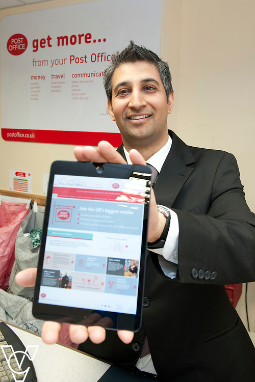 Pictured is postmaster Roopesh Naik holding an iPad displaying the new website - www.runapostoffice.co.uk<br /> <br /> Shirebrook Post Office Postmaster Roopesh Naik has recently taken over a second Post Office branch (Warsop) and plans to take on even more in the future.  He hopes the new website &ndash; www.runapostoffice.co.uk - will help him find the right opportunity.<br /> <br /> Date: May 23, 2015