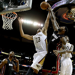 Oct 23, 2013; New Orleans, LA, USA; New Orleans Pelicans power forward Anthony Davis (23) and Miami Heat small forward LeBron James (6) battle for a rebound during the first half of a preseason game at New Orleans Arena. Mandatory Credit: Derick E. Hingle-USA TODAY Sports