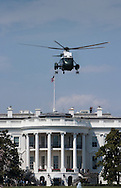 Marine One lifting off from the White House South Lawn, located at 1600 Pennsylvania Avenue NW.