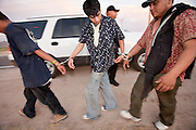17 MAY 2006 - GILA BEND, AZ: Handcuffed undocumented immigrants walk to a waiting transport van after being arrested on Old King's Highway near Gila Bend Wednesday. PHOTO BY JACK KURTZ