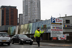 © Licensed to London News Pictures . 15/08/2018. Manchester , UK . Police manage traffic as streets surrounding the scene are cordoned off . A mill is on fire on Southall Street , believed to be at number 28 , opposite HMP Manchester ( Strangeways Prison ) . Firefighters report the fire started just before 5am this morning (15th August 2018) . Large parts of the mill , which appears to be for sale , have collapsed . Photo credit : Joel Goodman/LNP