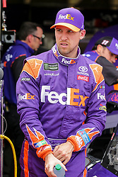 April 6, 2018 - Fort Worth, TX, U.S. - FORT WORTH, TX - APRIL 06: Monster Energy NASCAR Cup Series driver Denny Hamlin (11) gets out of his car during the Monster Energy NASCAR Cup Series practice on April 6, 2018 at the Texas Motor Speedway in Fort Worth, Texas. (Photo by Matthew Pearce/Icon Sportswire) (Credit Image: © Matthew Pearce/Icon SMI via ZUMA Press)