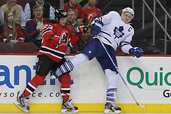 Mar 23; Newark, NJ, USA; New Jersey Devils right wing David Clarkson (23) hits Toronto Maple Leafs defenseman Dion Phaneuf (3) during the second period at the Prudential Center.
