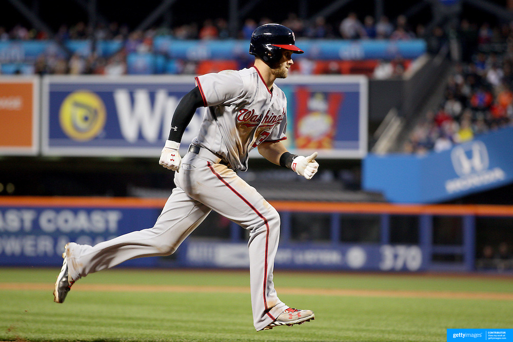 NEW YORK, NEW YORK - May 19: Bryce Harper #34 of the Washington Nationals scores a run during the Washington Nationals Vs New York Mets regular season MLB game at Citi Field on May 19, 2016 in New York City. (Photo by Tim Clayton/Corbis via Getty Images)