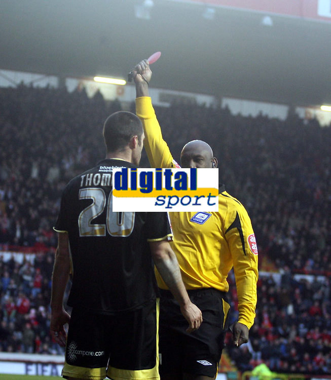 Photo: Mark Stephenson/Sportsbeat Images.<br /> Bristol City v Cardiff City. Coca Cola Championship. 15/12/2007.Referee Mr U Rennie shows Cardiff's Steven Thompson a red card after a bad challenge on Bristol's keeper Adriano Basso