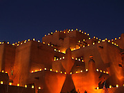 The Inn at Loretto during Christmas time, Santa Fe, New Mexico. The lighted bags are known as farolitos and are a traditional holiday decoration of the Southwestern United States.