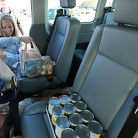 "Ericka Jones, Field Educator at The Family Resource Center in Tupelo, loads their van with donated food at the Crosstown Kroger during the ""Help Fill Our Van"" emergency food drive Wednesday afternoon. The drive will start back up on Friday from 1-6."