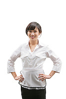Portrait of an Asian house cleaner with hands on hips over white background