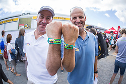 Riaan Launspach & Gary Kirsten show of their armbands with race numbers during the pre race events held at the V&A Waterfront in Cape Town prior to the start of the 2017 Absa Cape Epic Mountain Bike stage race held in the Western Cape, South Africa between the 19th March and the 26th March 2017<br /> <br /> Photo by Dominic Barnardt/Cape Epic/SPORTZPICS<br /> <br /> PLEASE ENSURE THE APPROPRIATE CREDIT IS GIVEN TO THE PHOTOGRAPHER AND SPORTZPICS ALONG WITH THE ABSA CAPE EPIC<br /> <br /> ace2016