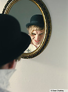 Oliver, looking in a mirror, dressed as a droog from A Clockwork Orange, wearing a German military cross, Southend, UK 2006