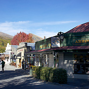 Arrowtown mainstreet in Autumn..Arrowtown is the much visited, historic, 4-season, southern hemisphere holiday destination, located only 20 minutes drive from Queenstown, South Island, New Zealand..Arrowtown is a former gold-mining town built on the banks of the Arrow River, once a rich source of gold in the 1860's and now a sophisticated, multi-cultural town catering visitors from around the globe. Arrowtown offers an ambiance with its shops, restaurants, cafes, offices and galleries located within a tight precinct.  5th April 2011.  Photo Tim Clayton.