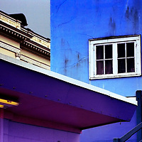 Buildings painted blue and purple