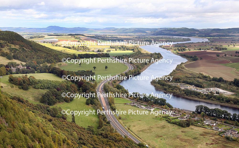 Perth Sewage Treatment plant on the banks of the River Tay, residents of West Kinfauns (pictured this side of the river) and nearby Kinfauns Castle owned by Ann Gloag (pictured far left of pic) are concerned over the unpleasant smell.<br /> Picture by Graeme Hart.<br /> Copyright Perthshire Picture Agency<br /> Tel: 01738 623350  Mobile: 07990 594431