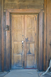 closed rustic weathered double wooded doors