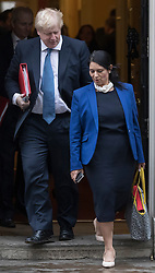 © Licensed to London News Pictures. 31/01/2017. London, UK. Foreign Secretary Boris Johnson talks with International Development Secreatry Priti Patel as they leave Downing Street after Cabinet before attending Parliament for the European Union withdrawal bill debate. Photo credit: Peter Macdiarmid/LNP