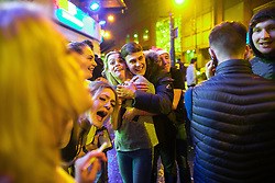 """© Licensed to London News Pictures . 23/12/2017. Manchester, UK. Revellers out on Withy Grove outside the Printworks in Manchester City Centre overnight during """" Mad Friday """" , named for being one of the busiest nights of the year for the emergency services in the UK . Photo credit: Joel Goodman/LNP"""