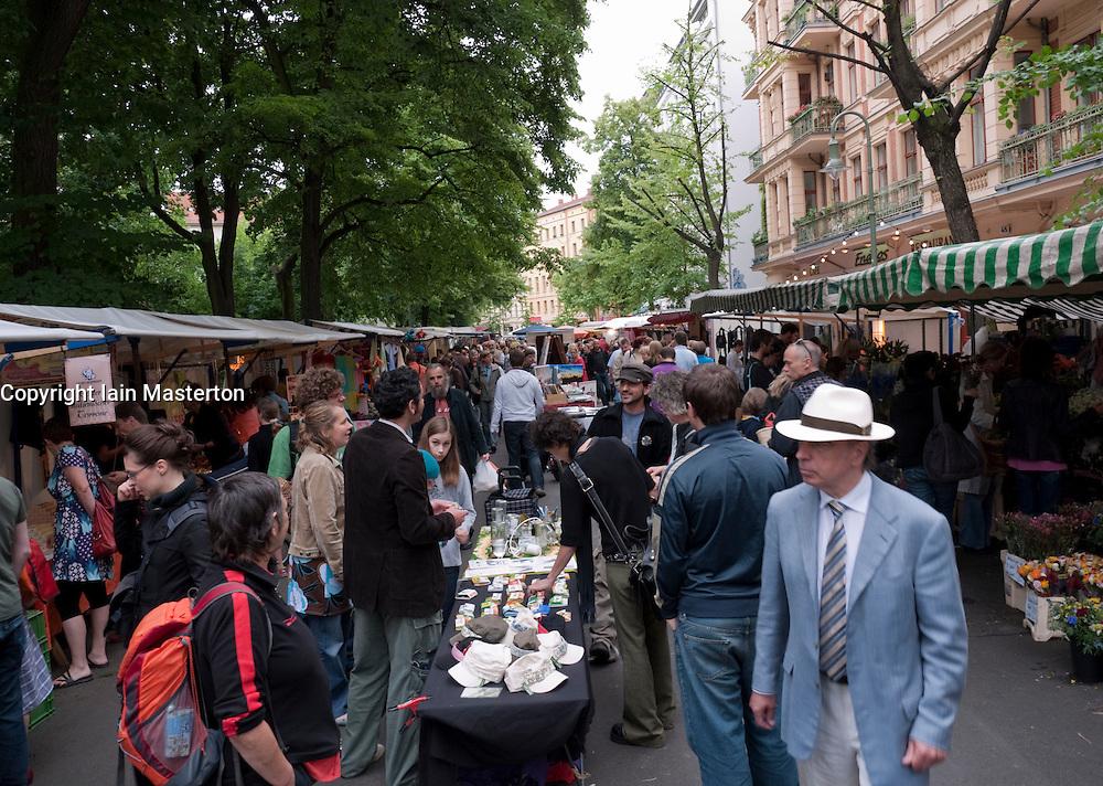 Busy weekend street market on Kollwitzplatz in Prenzlauer Berg district of Berlin Germany