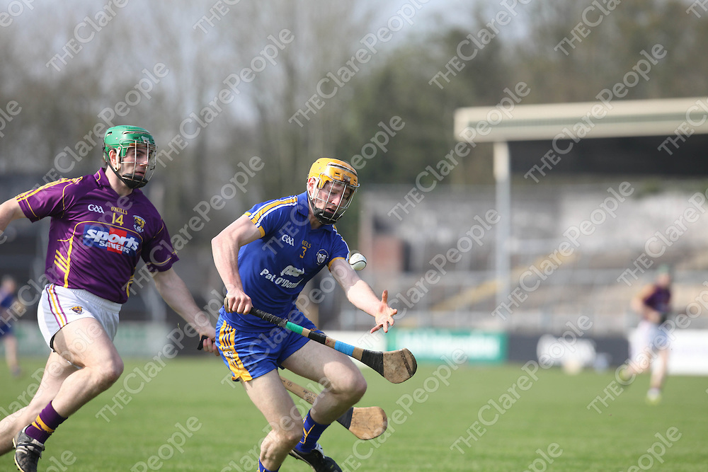 Clare's Cian Dillon and Wexfords Stephen Banville in action in Cusack Park on Sunday.<br /> Pic. Brian Arthur/ Press 22.