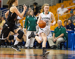 Wyoming East guard Gabby Lupardus (32) tries to get to the basket against Bluefield during a first round game at the Charleston Civic Center.