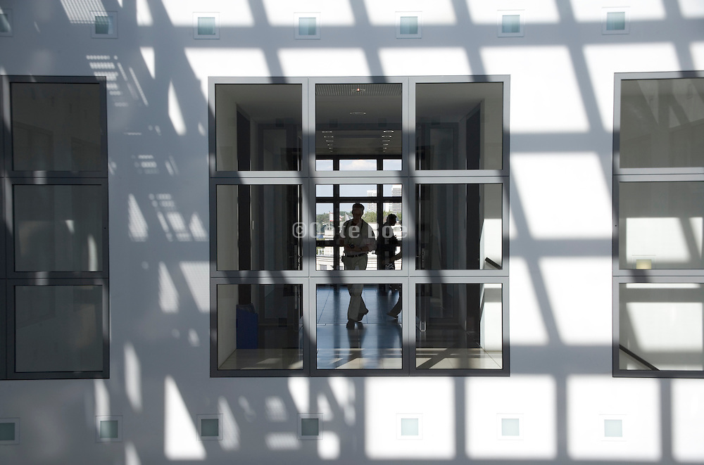 view through a window to the other side of the building with men walking