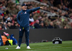 Middlesbrough manager Tony Pulis (left) reacts during the game against Wigan Athletic at the Riverside Stadium.