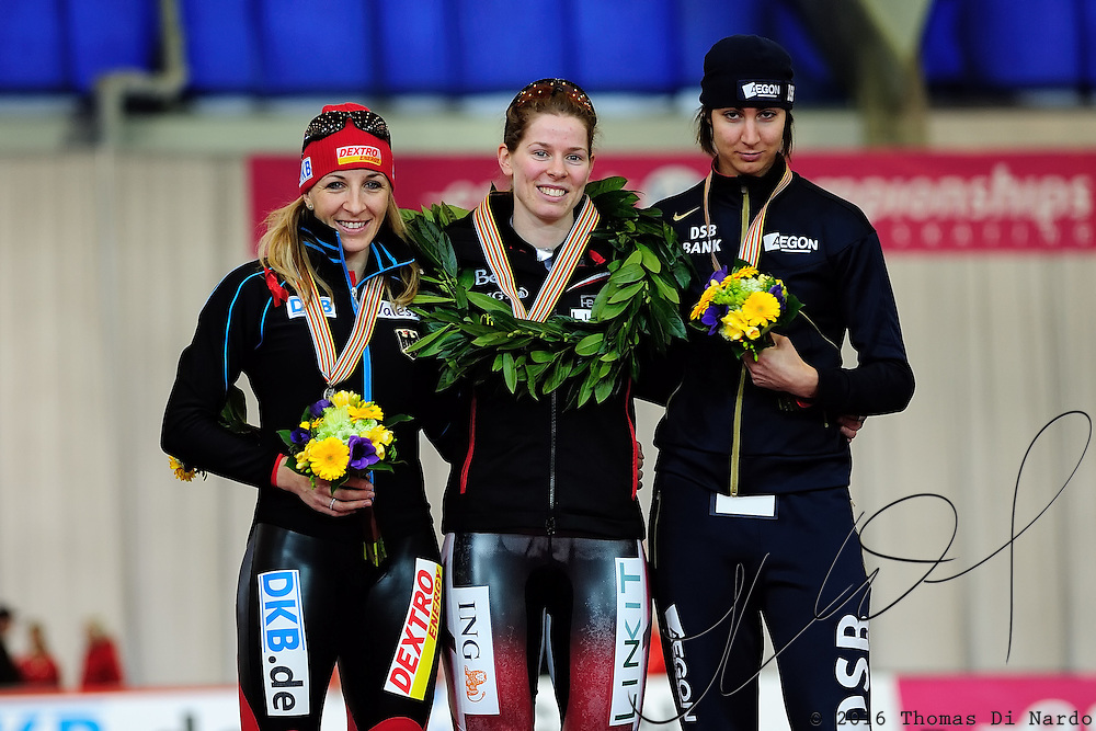 Christine Nesbitt (CAN), Anni Friesinger (GER) and Margot Boer (NED) celebrate during the awards ceremony for the 1000m competition at the 2009 ISU World Single Dinstances Speed Skating Championships at the Vancouver Olympic Oval in Richmond, BC, Canada on March 14, 2009.