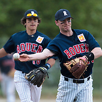 25 April 2010: Aaron Hornostaj of Rouen throws the ball to first base in front of Maxime Lefevre during game 2/week 3 of the French Elite season won 12-0 by Rouen over the PUC, at the Pershing Stadium in Vincennes, near Paris, France.