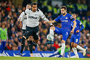 Chelsea midfielder Cesc Fabregas (4) puts the ball past Derby County midfielder Tom Huddlestone (44) during the EFL Cup 4th round match between Chelsea and Derby County at Stamford Bridge, London, England on 31 October 2018.