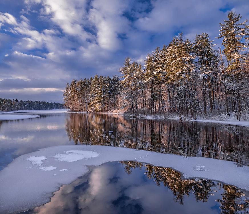 First light on snowy winter shoreline of Massabesic Lake, with ice & open water, Auburn, NH