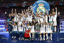 goalkeeper Keylor Navas of Real Madrid, Daniel Carvajal of Real Madrid, Sergio Ramos of Real Madrid with UEFA Champions League trophy, Coupe des clubs Champions Europeens, Raphael Varane of Real Madrid, Cristiano Ronaldo of Real Madrid, Toni Kroos of Real Madrid, Karim Benzema of Real Madrid, Luka Modric of Real Madrid, Gareth Bale of Real Madrid, Marcelo of Real Madrid, Casemiro of Real Madrid, Isco of Real Madrid, goalkeeper Kiko Casilla of Real Madrid, Nacho of Real Madrid, Gareth Bale of Real Madrid, Theo Hernandez of Real Madrid, Lucas Vazquez of Real Madrid, Marco Asensio of Real Madrid, Mateo Kovacic of Real Madrid, coach Zinedine Zidane of Real Madrid during the UEFA Champions League final between Real Madrid and Liverpool on May 26, 2018 at NSC Olimpiyskiy Stadium in Kyiv, Ukraine