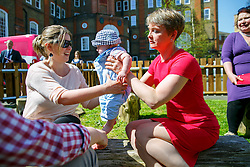 © Licensed to London News Pictures. 15/04/2015. LONDON, UK. Labour Party's Shadow Home Secretary Yvette Cooper holding Janosch, 5 months old, whilst meeting mothers and children at Stockwell Gardens Nursery in south London to launch Labour's Women's Manifesto on Wednesday, 15 April 2015. Photo credit : Tolga Akmen/LNP