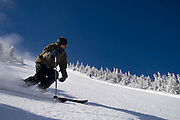 Skier against blue sky in Maine