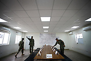 ANA officers prepare a meeting room for talks with their afghan Camp Pamir Commander.