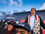 """10 DECEMBER 2019 - DES MOINES, IOWA: ANDREW YANG speaks in front of his bus parked at the Iowa State Capitol during a rally before the start of his bus tour. ang's supporters frequently wear hats with MATH embroidered on them. MATH is one of the slogans of his campaign and stands for """"Make America Think Harder."""" Yang, an entrepreneur, is running for the Democratic nomination for the US Presidency in 2020. He kicked off a five day bus tour today at the Iowa State Capitol in Des Moines. Iowa hosts the the first election event of the presidential election cycle. The Iowa Caucuses will be on Feb. 3, 2020.        PHOTO BY JACK KURTZ"""
